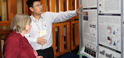 Toronto_POGO Symposium_Researcher_demonstrating poster board_education header