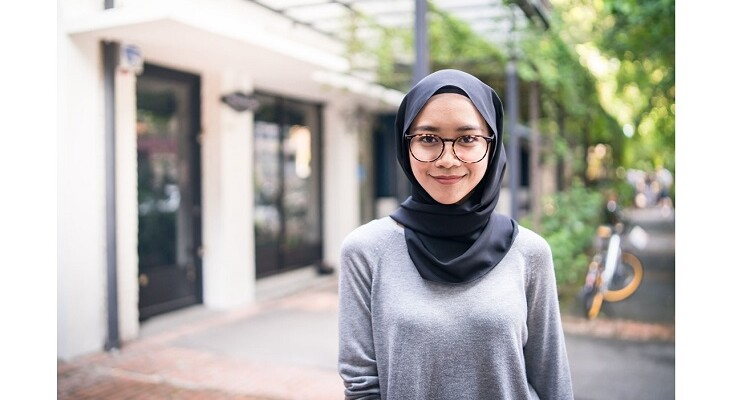 Young woman in hijab looking at camera